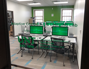 Photo of the Adaptive Computing and Learning Lab as seen through the glass front door.